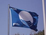 Když nad pláží vlaje modrá vlajka...